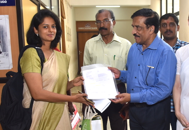 MR Thampan hands container to Collector