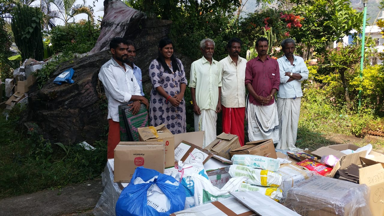 Tribal leaders receiving flood relief items