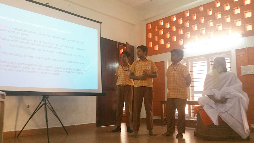Boys of Isa Viswa Vidyalayam presenting about the dangers of burning plastic